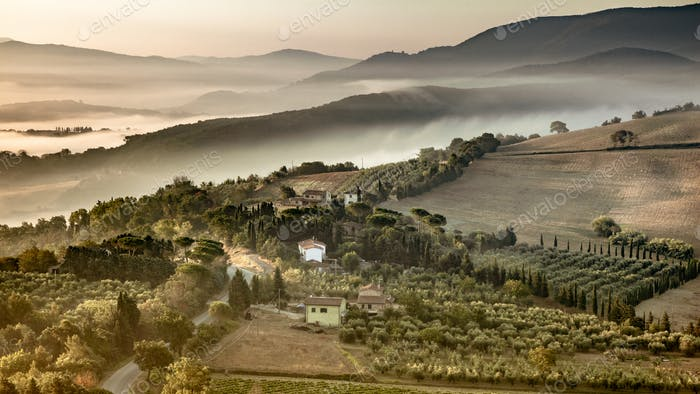 Tuscany foggy hills panorama view crop