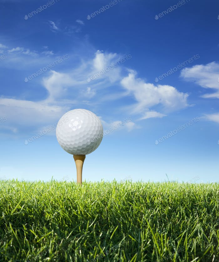 Low Angle View of Golf Ball on Tee with Grass Sky and Clouds