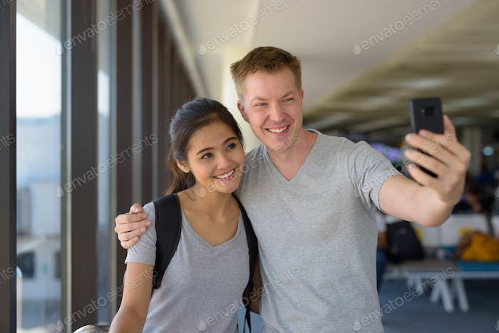 Portrait of young multi-ethnic couple enjoying vacation together