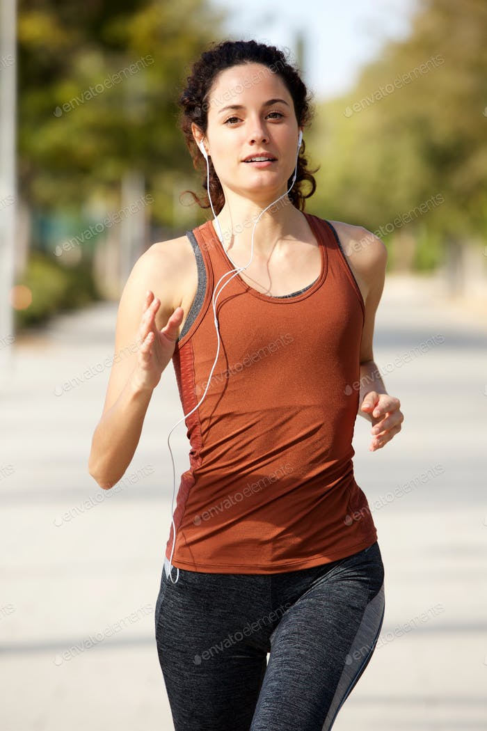 healthy young woman jogging outdoors