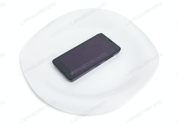 Modern mobile phone on a plate.