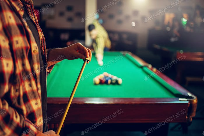 Two male billiard players start competition