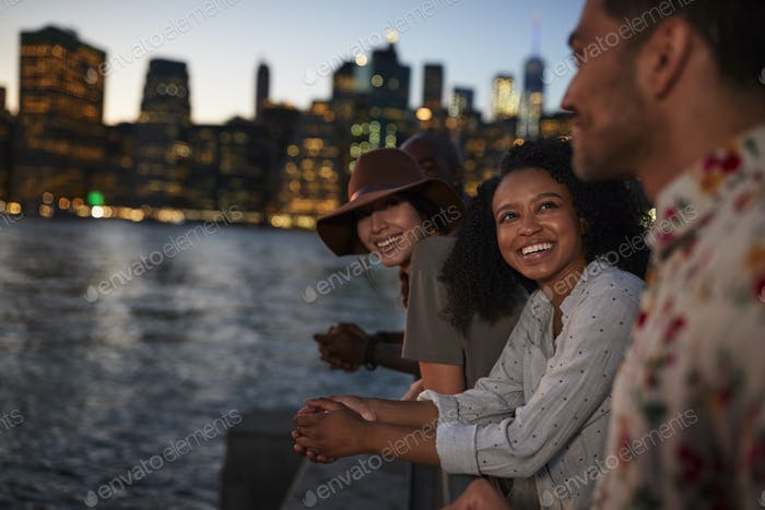 Group Of Young Friends On Trip To Manhattan At Dusk
