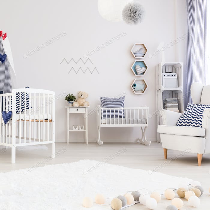 Baby room with simple white furniture