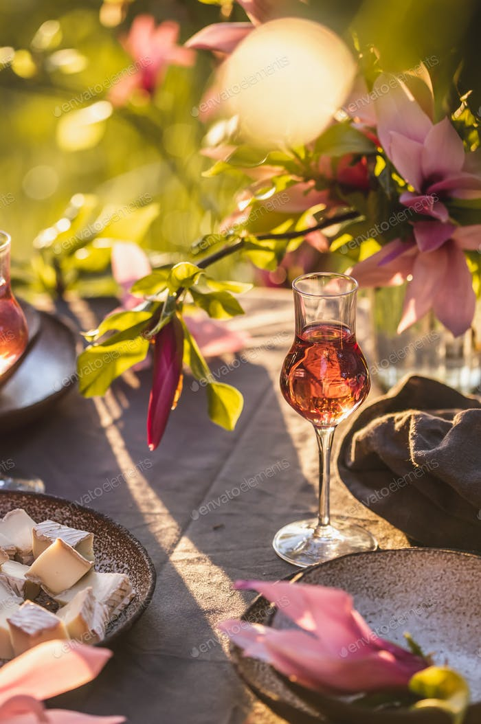 Beautiful table setting in garden on sunset light