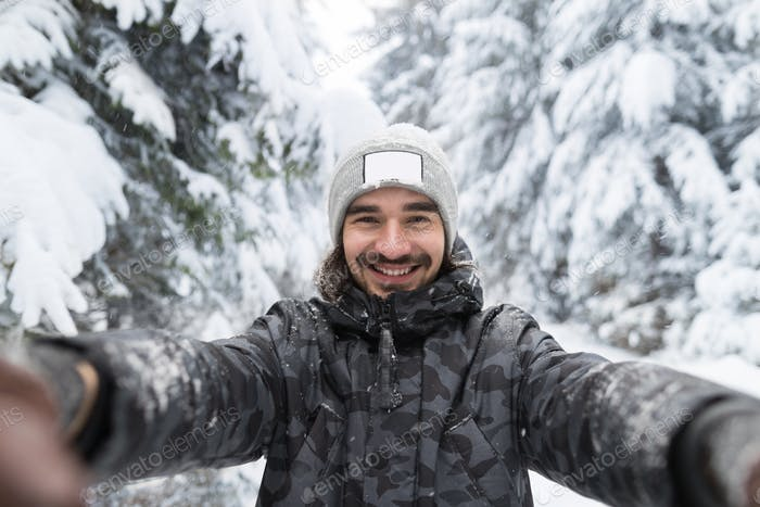 Young Man Smile Camera Taking Selfie Photo In Winter Snow Forest Guy Outdoors