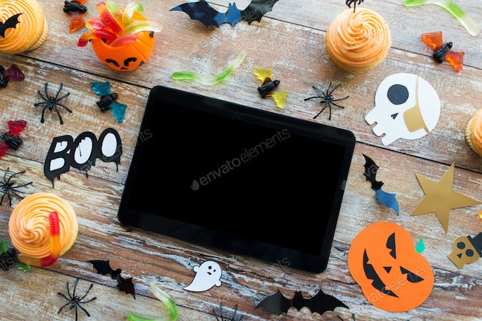 tablet pc, halloween party decorations and treats