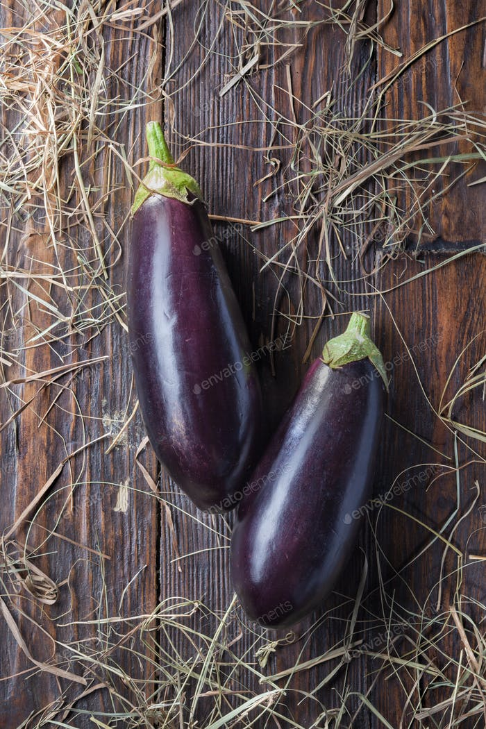 eggplants on wood
