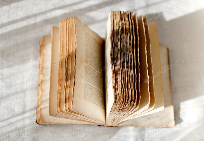 Open old book with faded pages