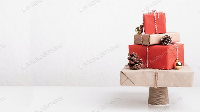 Creative Christmas tree of presents on white background