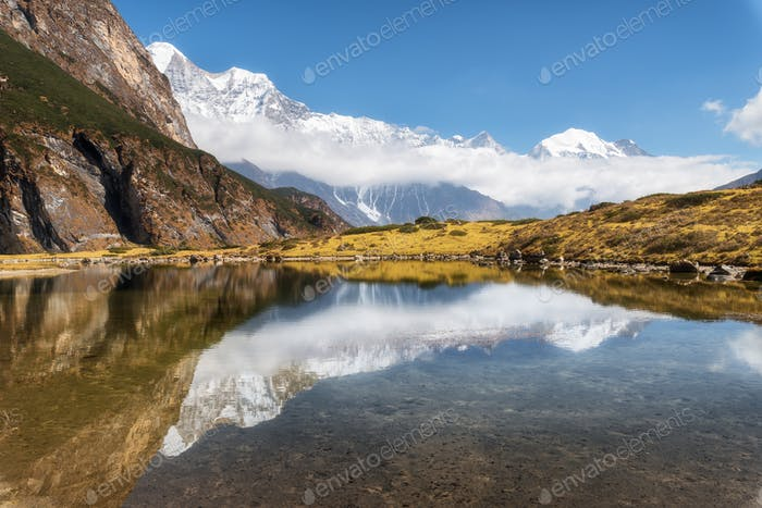 Majestic mountains with beautiful reflection in water