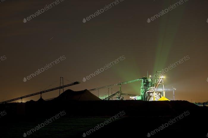Illuminated Gravel Plant At Night
