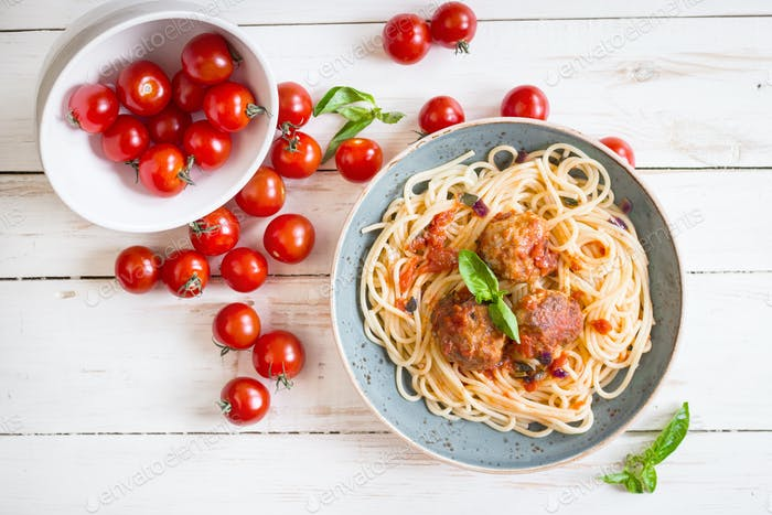 Spaghetti with meatballs and tomato sauce on a plate