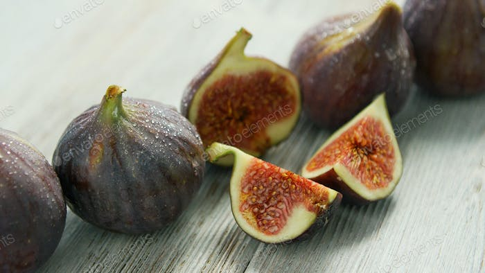 Row of figs on table