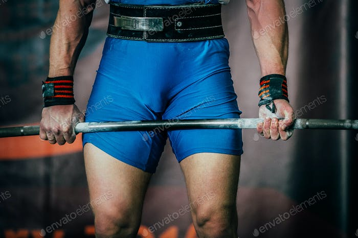 Man powerlifter and barbell