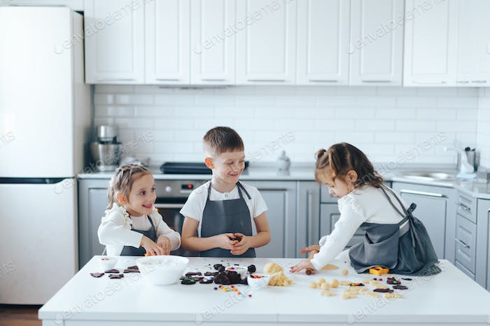 Children make cookies from dough. Leisure activity with children concept