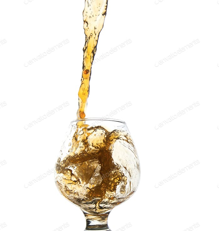 Whiskey being poured into a glass.
