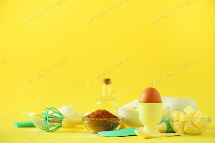 Healthy baking ingredients - butter, sugar, flour, eggs, oil, spoon, rolling pin, brush, whisk, milk