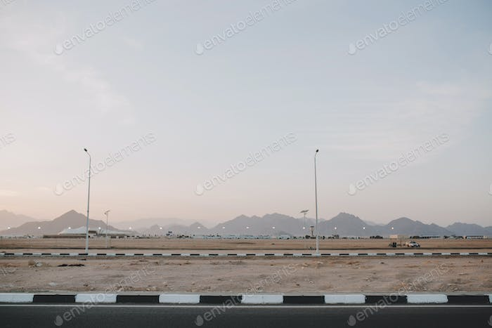 Early morning sunrise, landscape with mountains on road of tropical counrty. Blue sky, summer, natur