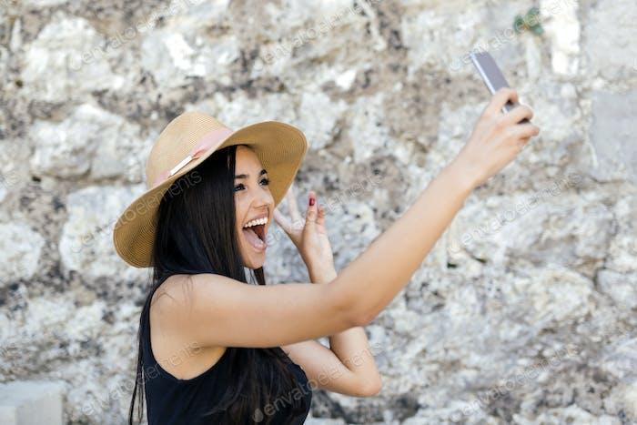 Beautiful girl taking a selfie
