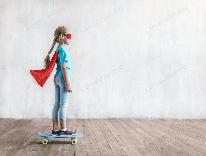 Little girl skating on a skateboard