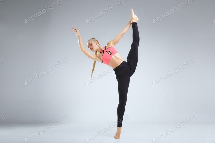 Dancer stretching in the studio