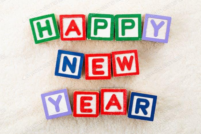 Feliz año nuevo bloque de juguetes