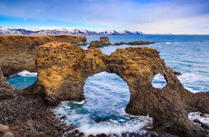 Natural rock gate in Arnarstapi, Snafellsnes peninsula, Iceland