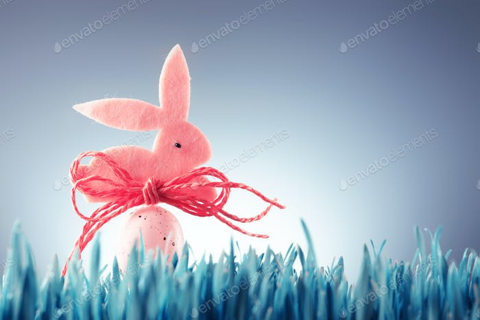 Easter background concept with pink bunny figure
