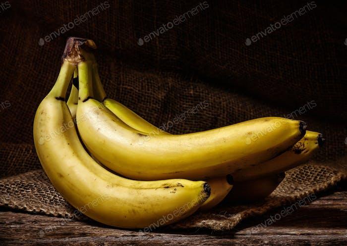 Yellow Bananas on a Wood Table