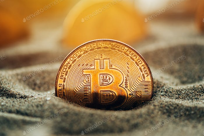 Bitcoins in sand