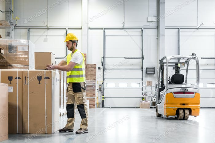 Warehouse worker taking package for delivery to customer