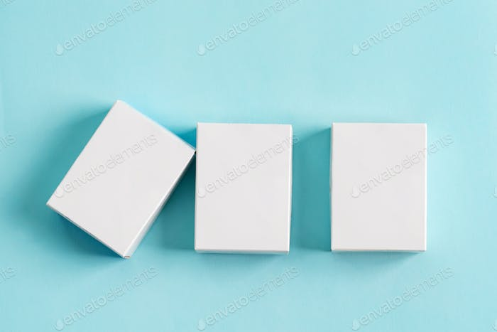 Set from three paper mock up boxes for packaging products and things on a pastel blue background