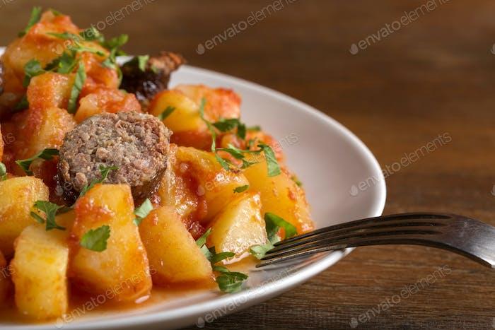 Potatoes stew with pork sausage