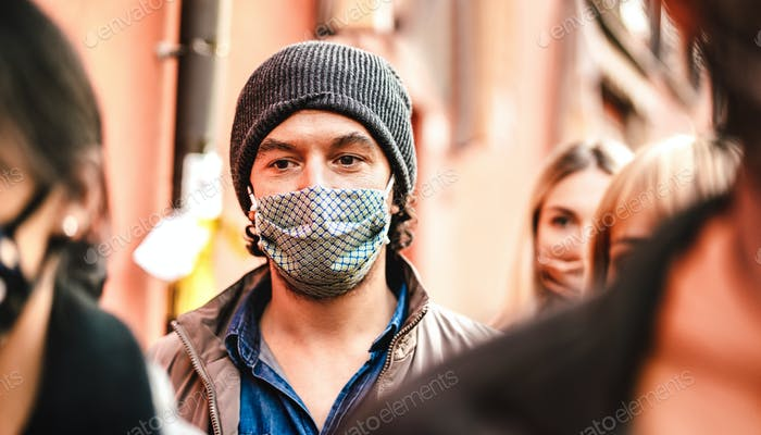 Urban crowd of citizens walking on city street wearing face mask