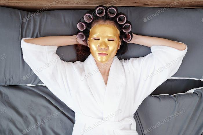 Woman sleeping with sheet mask on