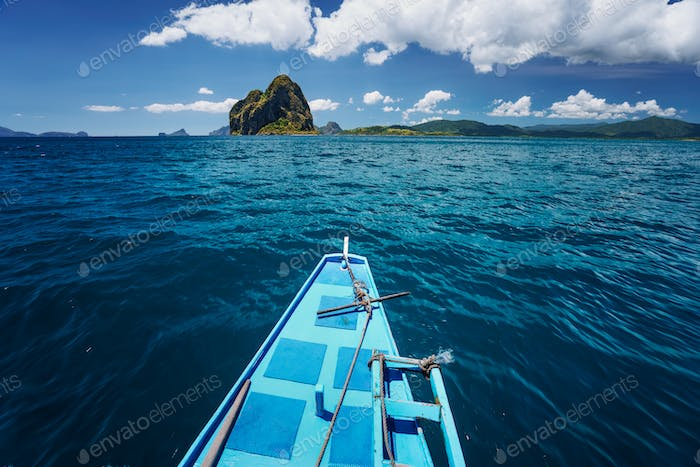 El Nido, Palawan, Philippines. Traditional banca boat on the way to amazing Pinagbuyatan Island. A