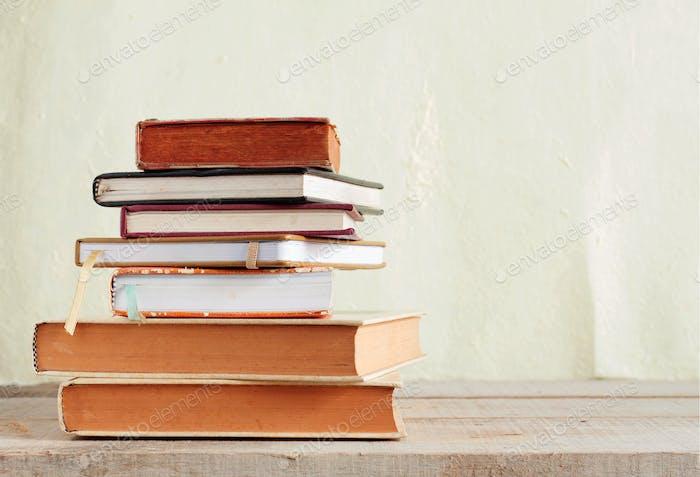 books on wooden floor