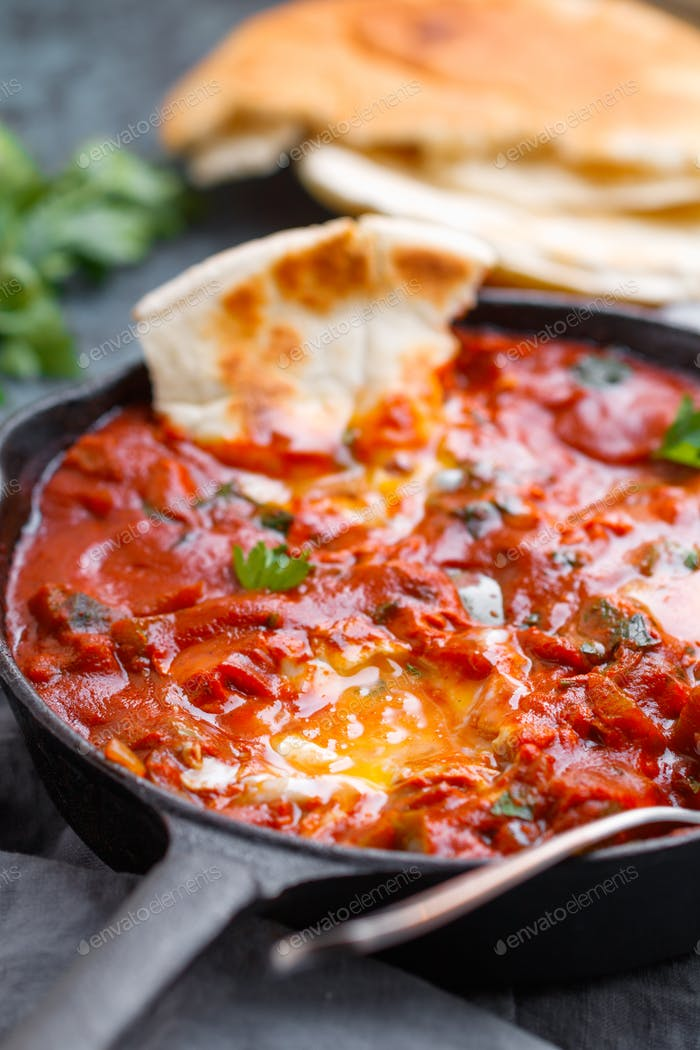 Traditional recipe of popular Middle Eastern dish shakshuka