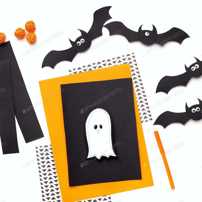 Happy Halloween ghost cut of paper on greeting card