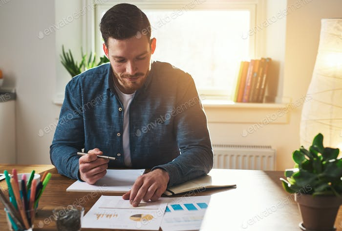 Entrepreneur working on business charts and graphs