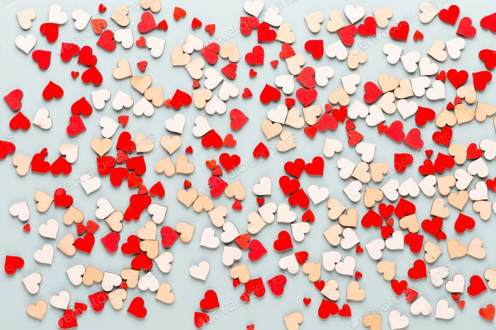 Valentines day background pastel  hearts on blue  background.