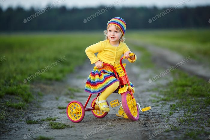girl with colorful dress on the bicycle