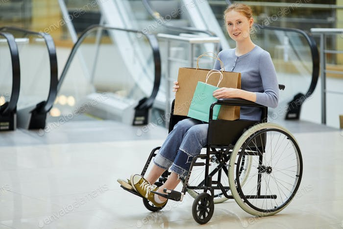 Disabled woman doing shopping