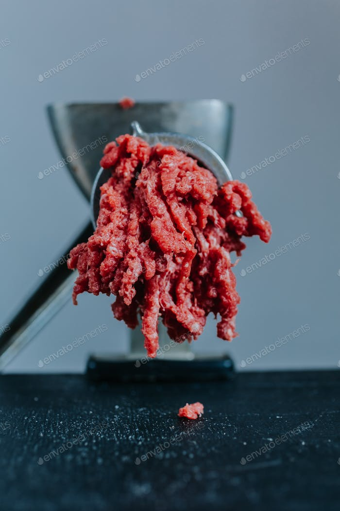 Meat in mincing machine