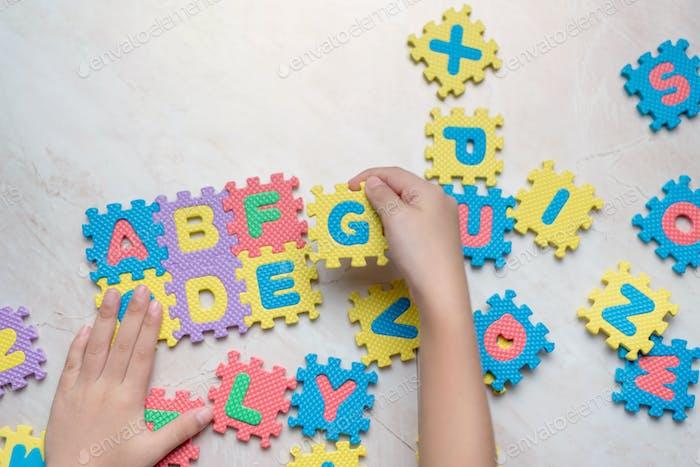 Child play alphabet puzzle