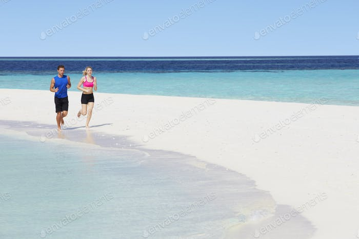 Couple Running On Beautiful Beach