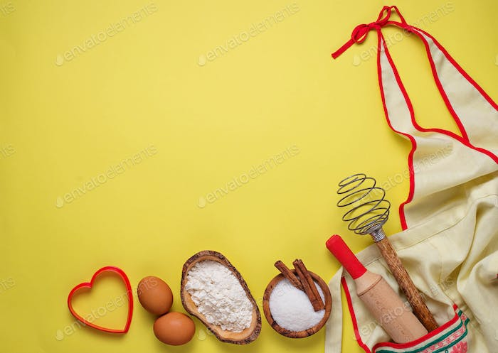 Ingredients for baking  on yellow background