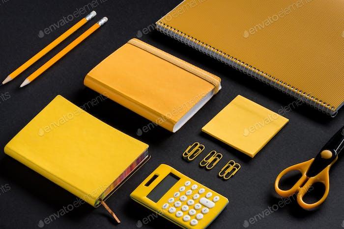 isometric mockup composition of yellow school supplies