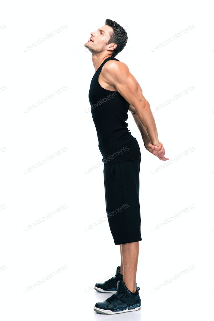 Fitness man stretching hands isolated
